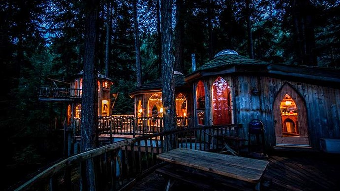 Forest House resides on Orcas Island, off the coast of Washington State, USA. The three-decked treehouse includes a tower, a reading nook, a hobbit-size kitchen and artisan cherry wood furniture. Tree elves would live here. _Image courtesy of [Suzanne Dege](http://www.templedreams.org/Orcas_Island_Retreat/Forest_House_on_Orcas_Island.html)_