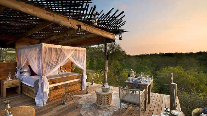 There's no better escape from the groundling world than up a treehouse. Kingston Treehouse in Sabi Sands Reserve, South Africa, is elevated above surrounding white boulders and savanna. Dine on a mezze-style picnic as the African sun sets the sky aflame, and then sleep under a canopy of stars. _Image courtesy of [Travel+Style](http://www.travelplusstyle.com/magazine/a-treehouse-night-at-the-lion-sands-private-game-reserve)._