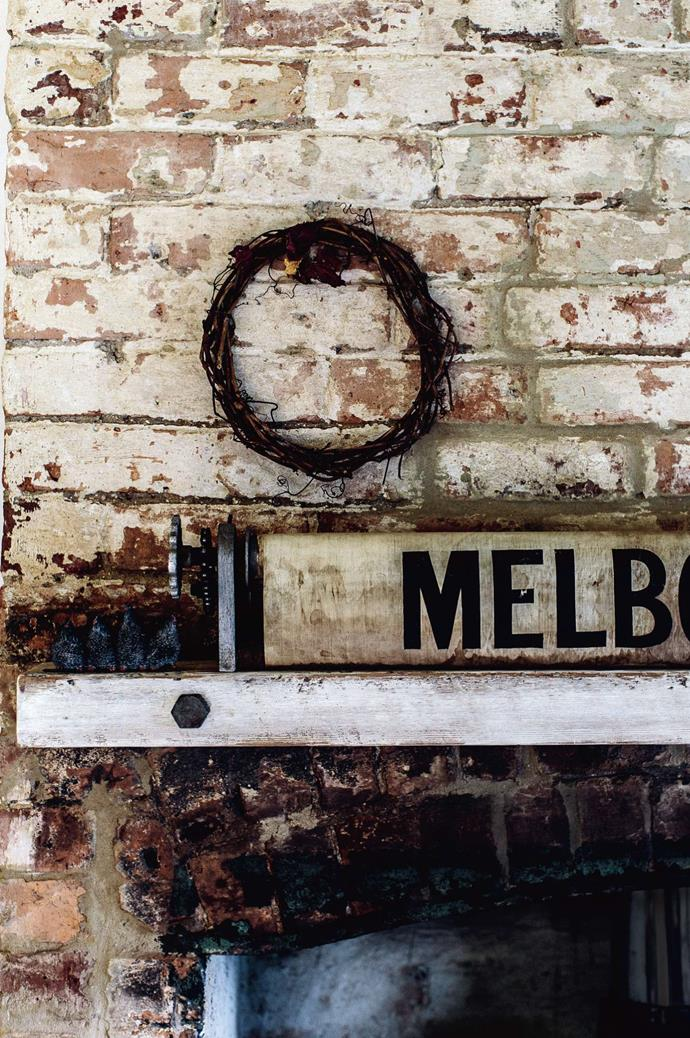 Julie and Noel's home is a former country police house on a two-hectare Elizabeth Town property, complete with a gaol. A Victorian bus scroll adorns the couple's restored vintage fireplace.