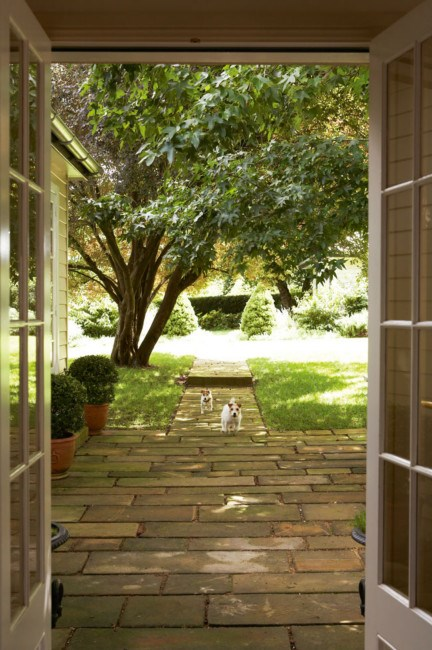 French doors opening on to a stone pathway | Photo: Michael Wee
