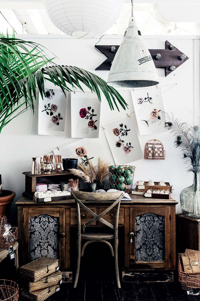 "This repurposed sideboard, now a desk, with painted wallpaper inlays was created by Noel. It sits beneath floral prints by [Deborah Bowness](https://www.deborahbowness.com/|target=""_blank""