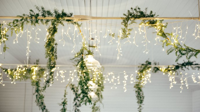 Use lighting to your advantage. You don't have to make do with the bare bulbs your rental comes with – getting creative with lights is a cheap and easy way to turn a small space from wanting to welcoming. Lamps, novelty lights, fairy lights, festoon lights and string bulbs will all add that little extra glow.  | Photo: Zoe McMahon