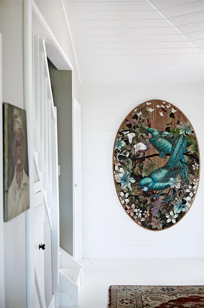 """Every piece in the house has a story to tell. Hanging adjacent to a stencil by Auckland artist, [Flox](https://flox.co.nz/ target=""""_blank"""" rel=""""nofollow""""), is a portrait of a turbaned Balinese man. """"We call him Ernie - he's appeared in quite a few TV commercials,"""" says Mel."""
