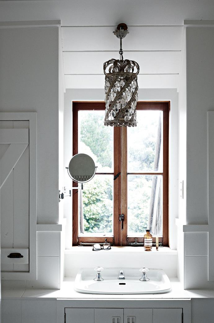 "A crystal chandelier is suspended above the upstairs bathroom. Varying sheens and strengths of [paint transformed](https://www.homestolove.com.au/the-power-of-paint-4102|target=""_blank"") the previously closed-in, dark interior into an airy space filled with light."