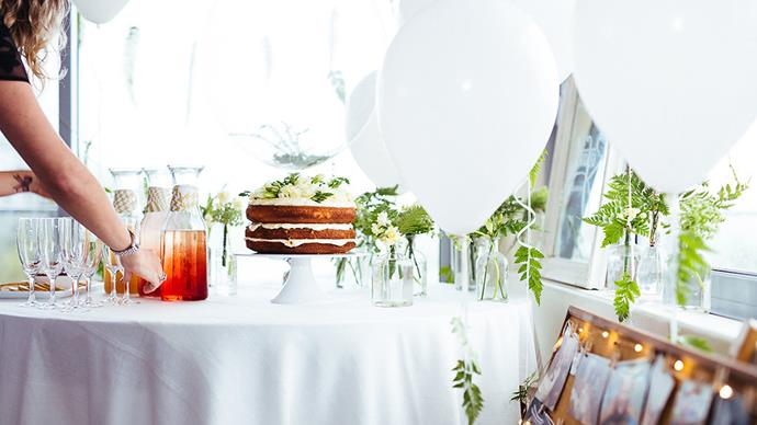 """On the day of the baby shower, the ambience was calm and light with decorations sourced from what was readily available. The tablecloth is a curtain taken from the wall. """"We had four balloons with greenery and eight simple white balloons - nothing extravagant, but all original and stunning,"""" says Nikki. 