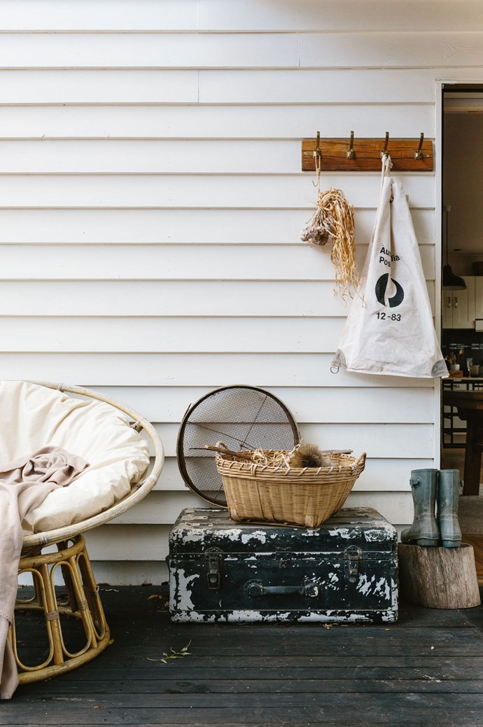 A vintage mail bag hangs on the back door, a relic of the letters that used to pass through.