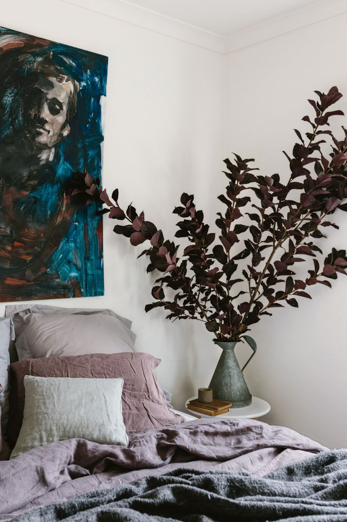 """A painting by Ryan's friend, Diarmaid Fennessy, hangs over linen by [In The Sac](https://inthesac.com.au/