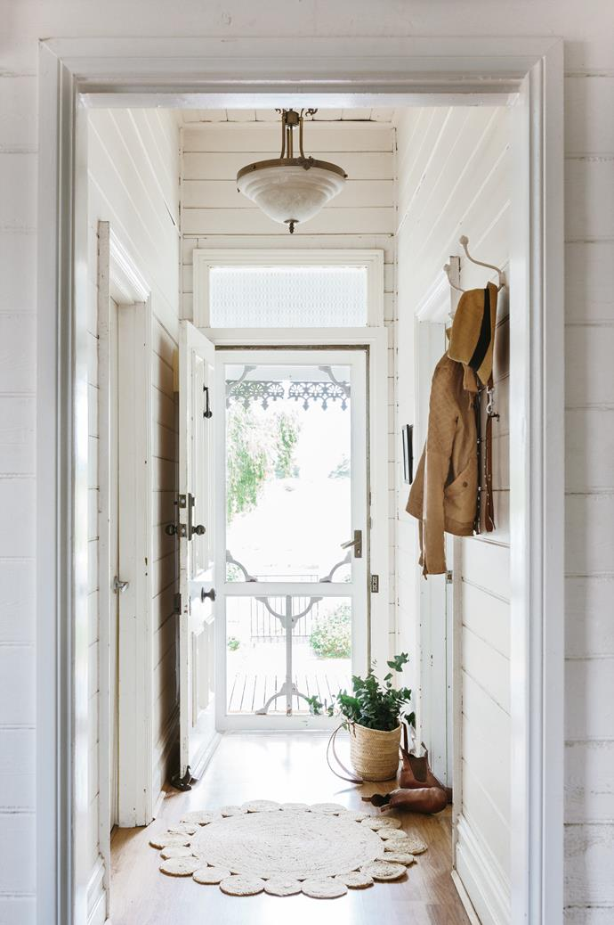 "The [front door](https://www.homestolove.com.au/front-doors-australia-6476|target=""_blank"") had been inexplicably absent when they moved in. The couple rescued a Federation screen door from eBay, now an essential fixture in their home."