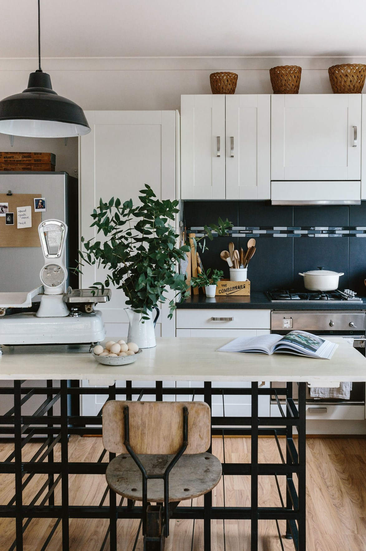"<p>**INTRODUCE INDUSTRIAL FINISHES AND FIXTURES** <p>Making a classic country kitchen seem brand new is easy with a touch of ultra-modern powdered black steel. Take [style ideas from photographer](https://www.homestolove.com.au/victorian-cottage-interior-ideas-13773|target=""_blank"") Marnie Hawson's cottage in the Macedon Ranges, and install a pair of [IKEA Ranarp pendant lights](https://fave.co/2BLgVjs