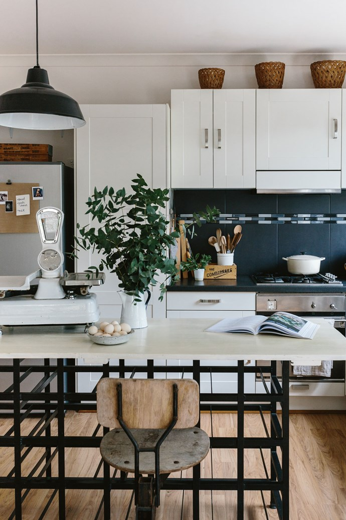 """""""We wanted something with character,"""" says Marnie. The bench of the kitchen island is made from an old [barn door](https://www.homestolove.com.au/maximise-space-and-style-with-barn-doors-6582