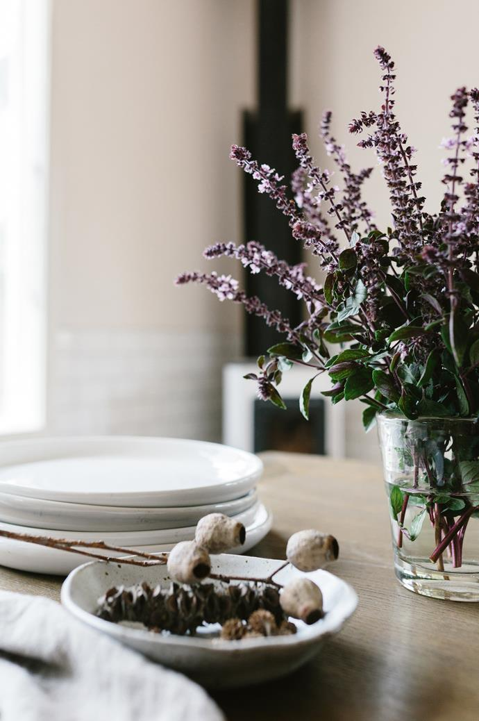 The dining table is decorated with local wares, including a ceramic bowl by Bridget Bodenham. Marnie often uses these furnishings as props in her photography.