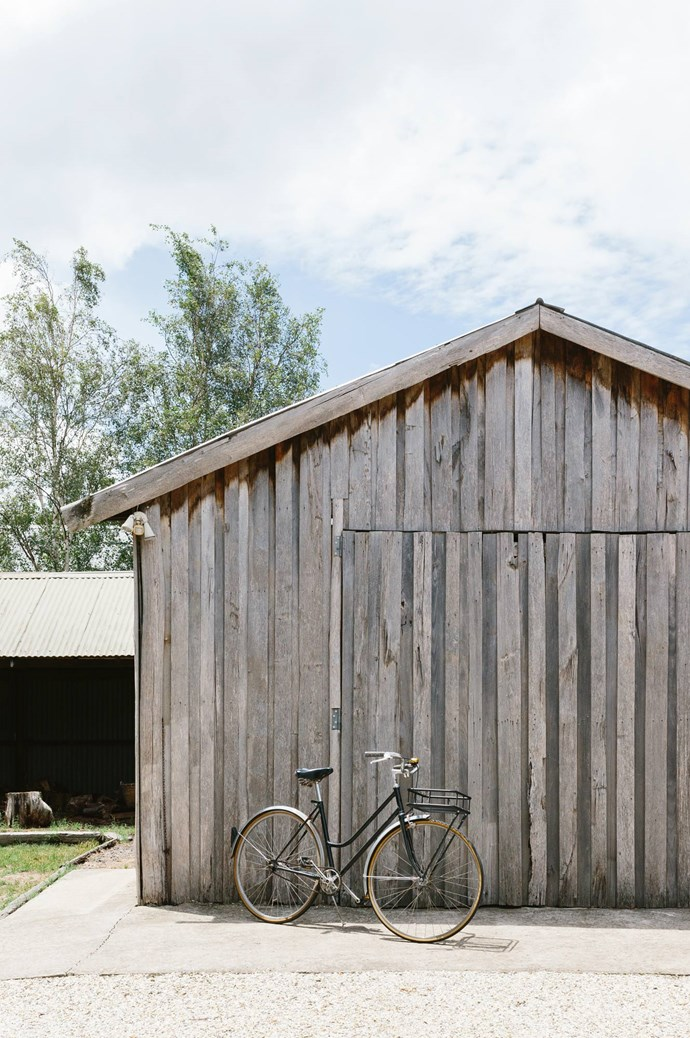 """A bicycle leans against the barn door. Marnie and Ryan care for their cottage while dreaming of an even simpler country life, in a cabin built off-grid and close to a forest. To see more of Marnie's work, visit the [Marnie Hawson's website](https://www.marniehawson.com.au/