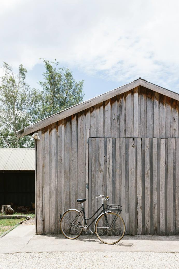 "A bicycle leans against the barn door. Marnie and Ryan care for their cottage while dreaming of an even simpler country life, in a cabin built off-grid and close to a forest. To see more of Marnie's work, visit the [Marnie Hawson's website](https://www.marniehawson.com.au/|target=""_blank""