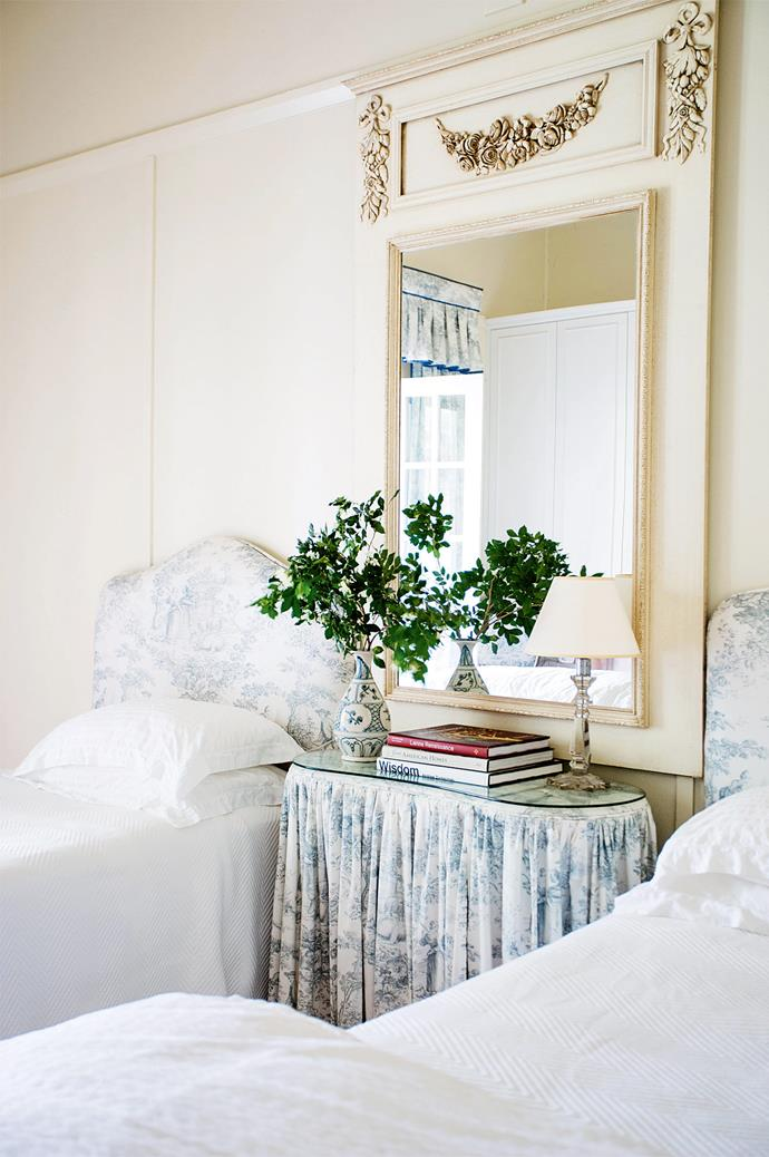 In the guestroom, blue toile was chosen for its calm, restful feel.