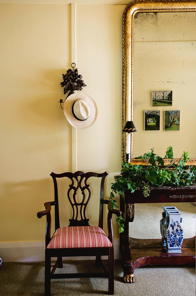 Creeping greenery on an antique desk complements miniature paintings of forestry. Nature and style go hand in hand.