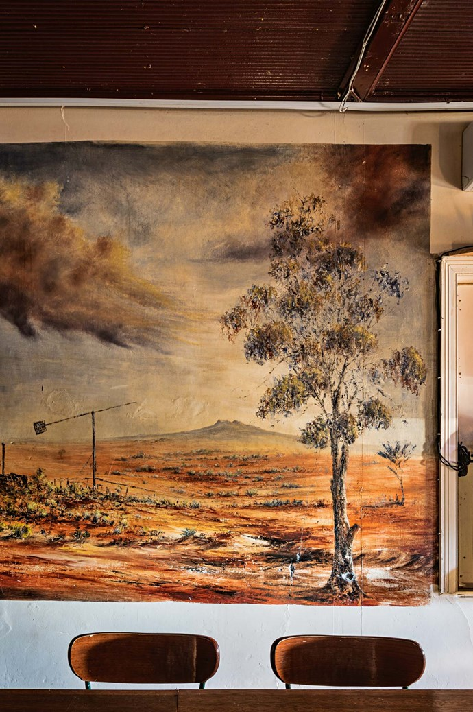 Visiting artists left these paintings, paying tribute to the arid landscapes that inspired them.
