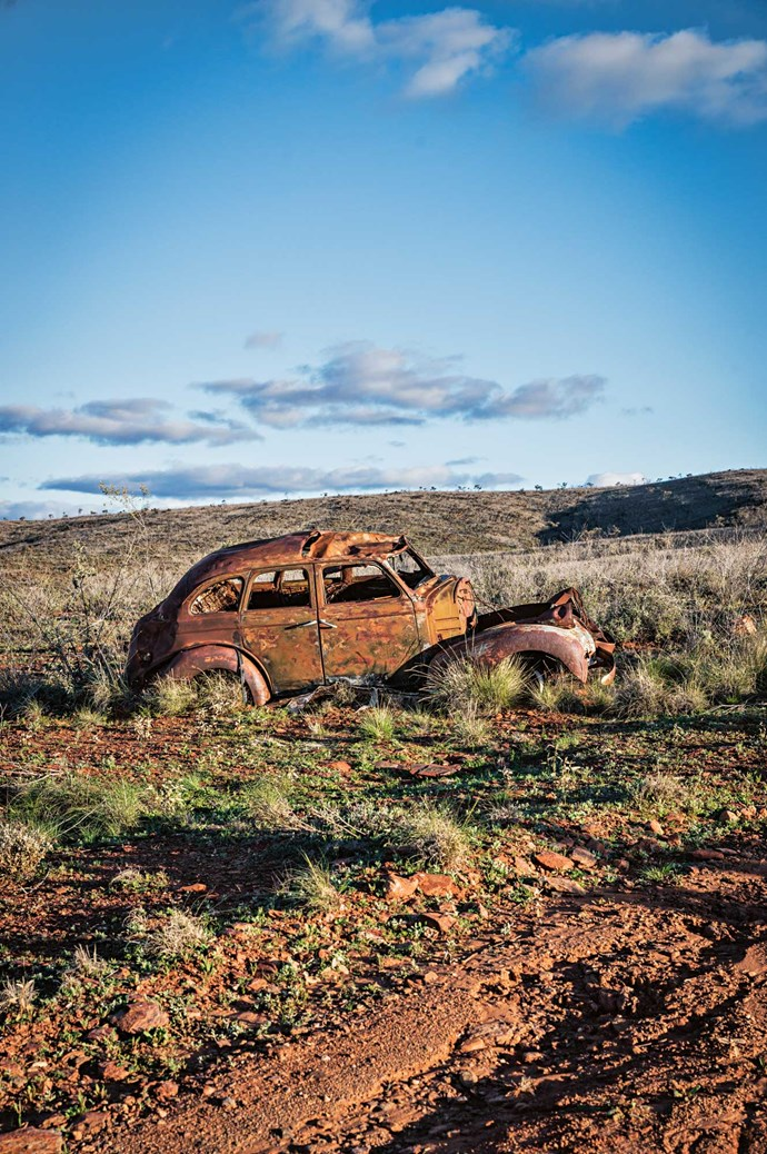 A rusted car skeleton near the former tin mine on Mount Gipps Station.