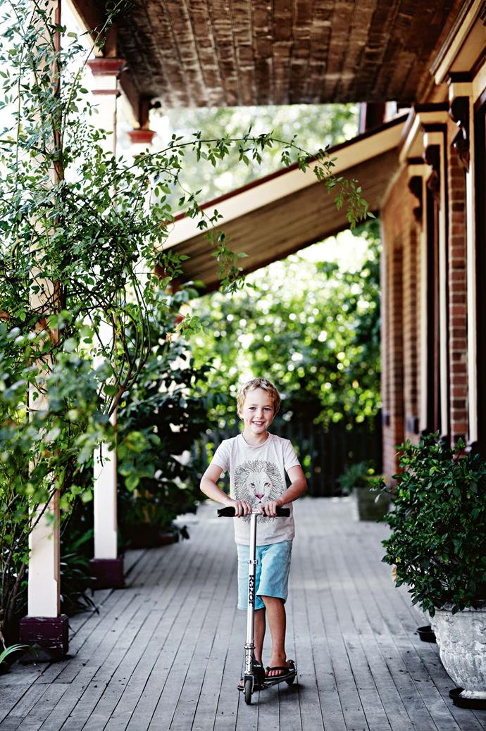 """Harvey cruises down the verandah. """"The kids spend their lives on bicycles and run around and explore,"""" Jonathan says. """"We'll go camping on the weekends and visit wineries, and there's always a festival."""""""