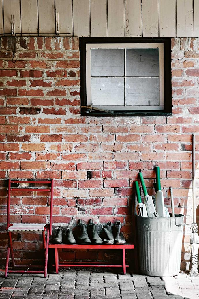 Cricket bats and beaten boots by the door are a testament to the family's active lifestyle.