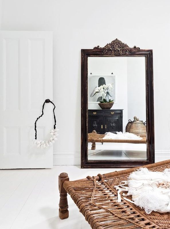 2. Mirror magic. While it might seem counterproductive, an oversized mirror makes a clever addition to a small room when used strategically.  Lean it up against a wall in a spot that allows it reflect natural light – this works particularly well in hallways – or hang several smaller ones together to bounce the sunlight around a room and create the illusion of windows.