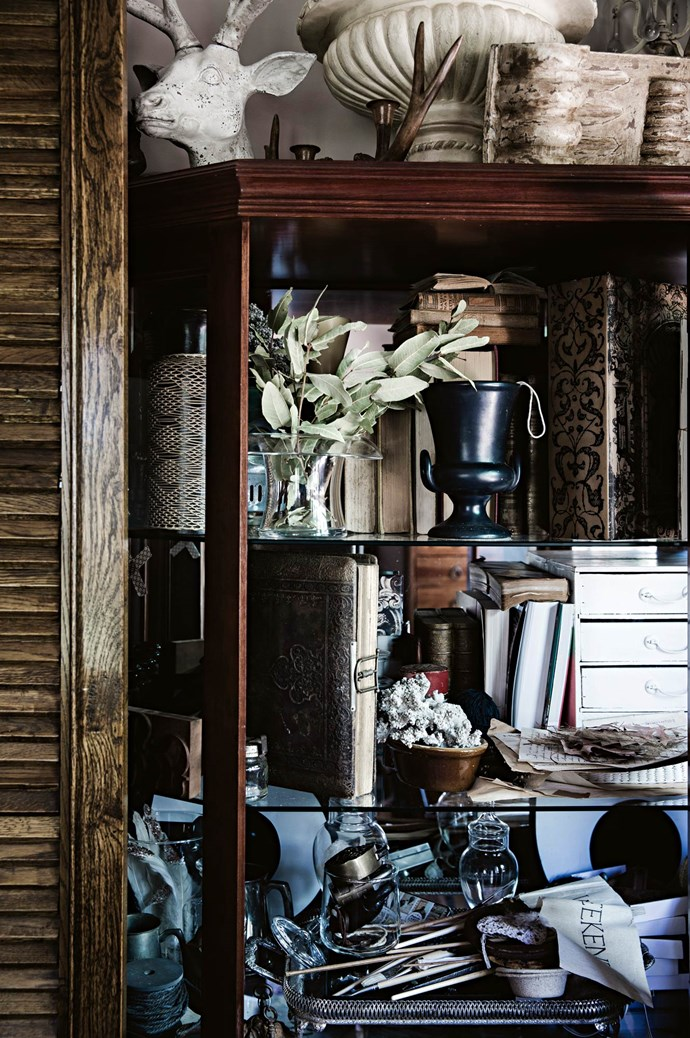"""Handsome cabinetry exhibits finds from flea markets and country swap meets. These collections grow endlessly under Heidi's thoughtful eye. """"No house of mine is ever finished… they just evolve,"""" she says.   Photo: Chris Warnes"""