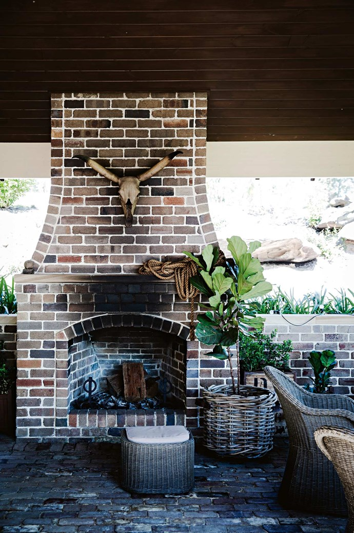 The entertaining area is an outdoor room, a more recent design that took almost a year to construct. The fireplace in the outdoor room is made from recycled bricks found in a Lakemba demolition yard.