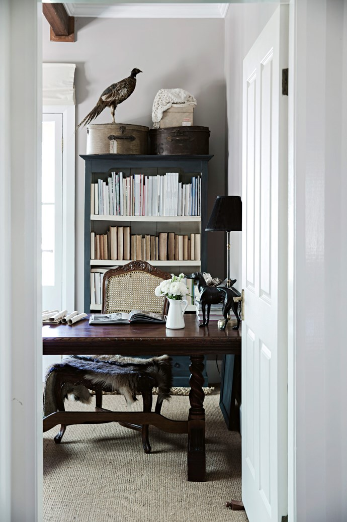 The study room features taxidermy, fur throws and antique furniture. Its French doors open up to the verandah.   Photo: Chris Warnes