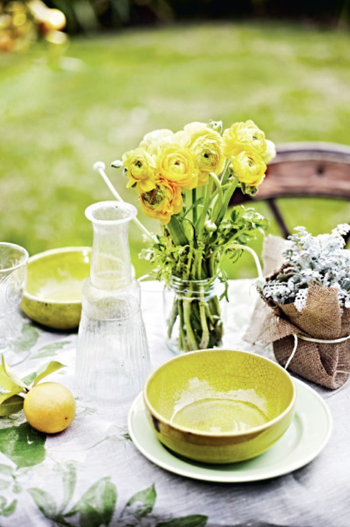 2.  Experiment with mismatching shapes and styles of crockery and glasses. The greens, yellows and browns pictured create a casual, summery atmosphere. | Photo: Lisa Cohen