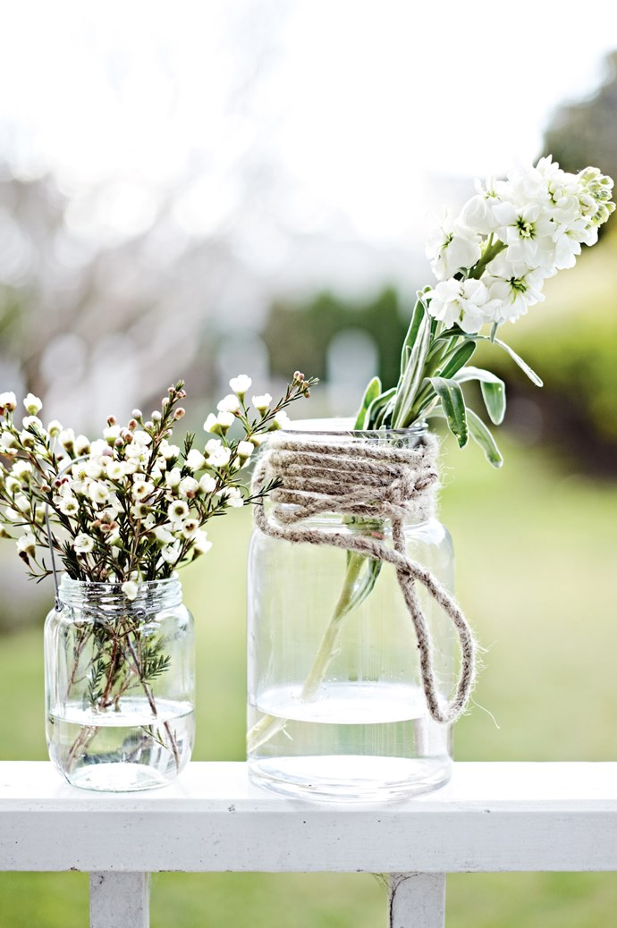 4. Use clear glass jam jars in all different shapes and sizes as an alternative to vases. Fill with luscious, white flowers for a clean, fresh look. | Photo: Lisa Cohen