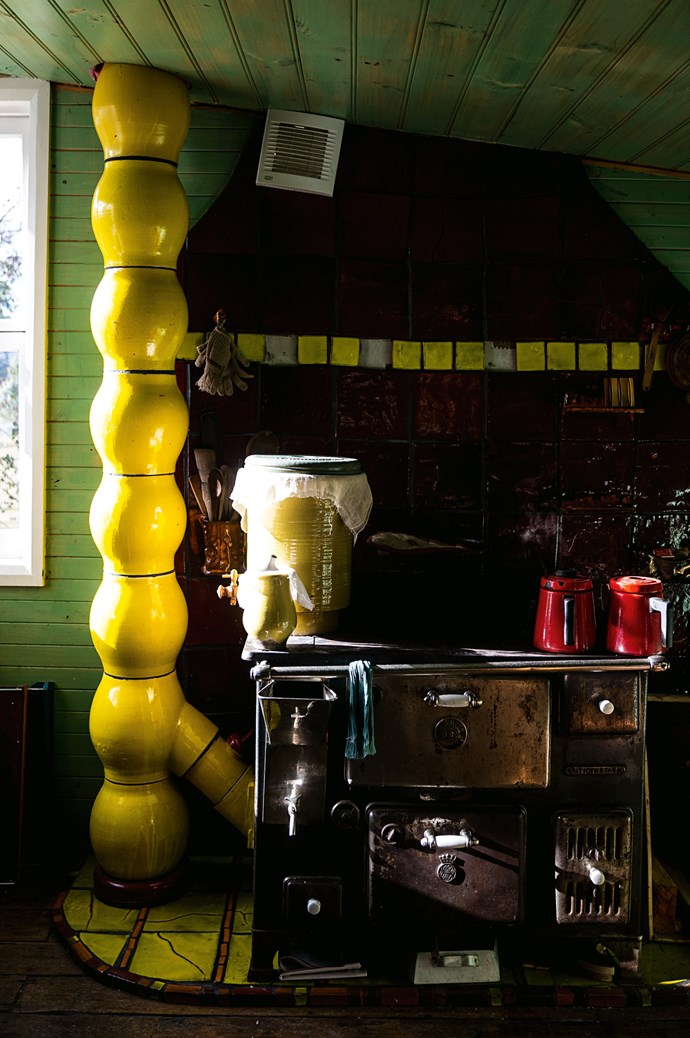 "The yellow chimney in the kitchen is, ""like a magnet, everyone goes straight to it,"" says Nanna."