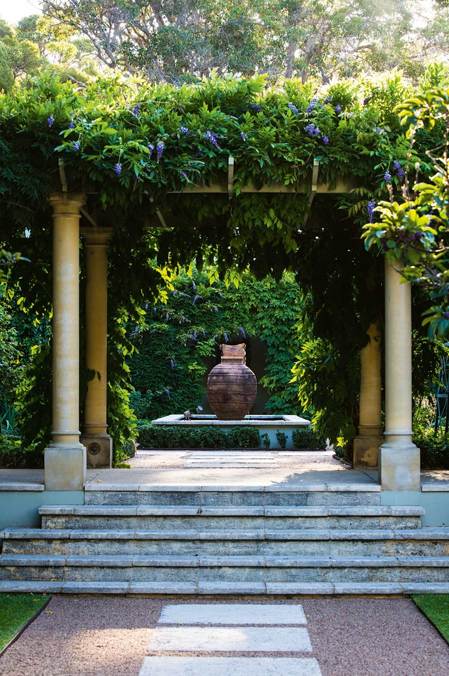 """A grand custom-designed water feature is the focal point of this magnificent [garden in Margaret River, WA](https://www.homestolove.com.au/hydrangea-garden-design-13870 target=""""_blank"""")"""