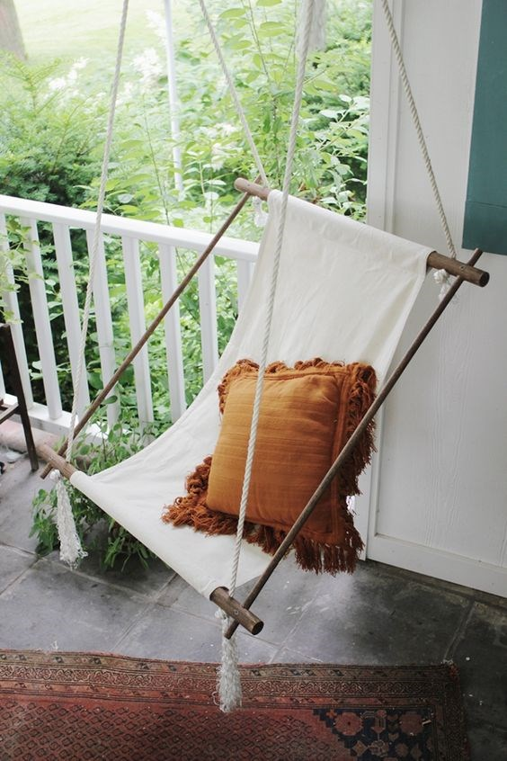 Every balcony needs a place to relax. This hanging chair delivers on function but doesn't take up too much space - essential when you don't have much to work with! Image courtesy of [Apartment Therapy](https://au.pinterest.com/apttherapy/)