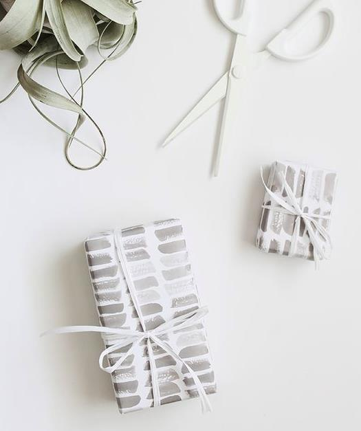 "**Masterstrokes of monochrome** - For something less bold but still beautiful, try this watercolour-inspired wrapping paper. Tie it up with a simple white ribbon for a less-is-more look. Print it off from [Almost Makes Perfect](http://almostmakesperfect.com/wp-content/uploads/2015/09/printable-watercolor-stroke-gift-wrap-almost-makes-perfect2.jpg|target=""_blank""