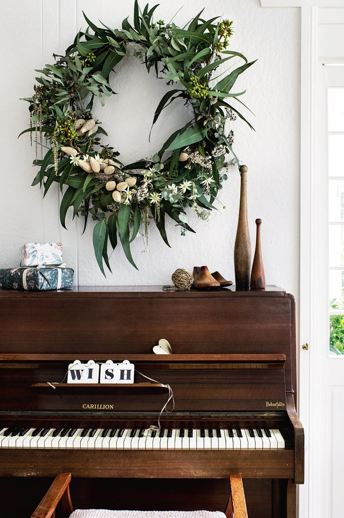 "A bush-inspired wreath from [My Violet](http://www.myviolet.com.au/) is suspended over the family piano. ""I could see the house's great character and knew that with a lot of hard work we could transform it into a place people would love to stay,"" Hayden says. 