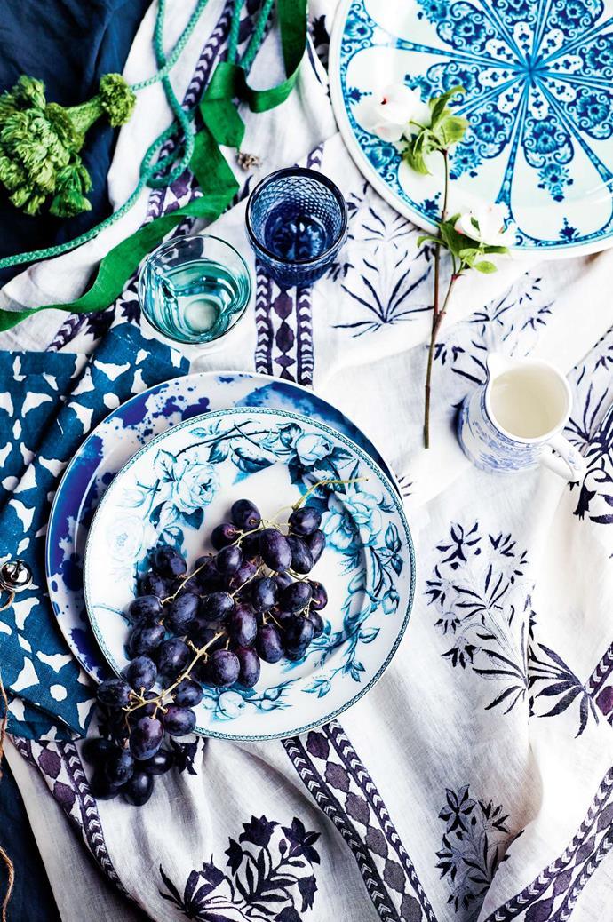 **Get creative with colour.** An outdoor Christmas calls for colour and pattern. We love the idea of a simple colour palette— like this one here, in blue and white — that mixes clashing patterns.