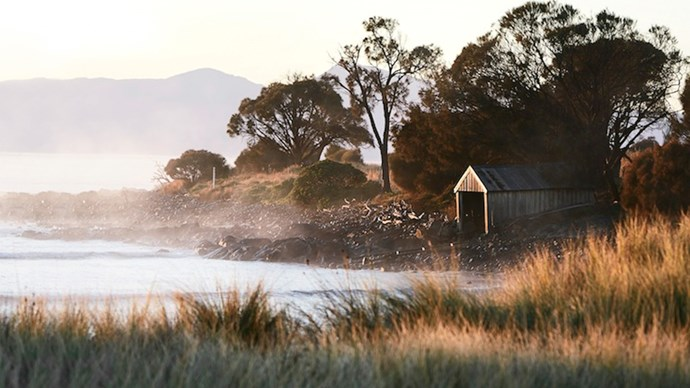 The morning fog lifting along the Freycinet Coast at Piermont. *Photo: Sharyn Cairns*