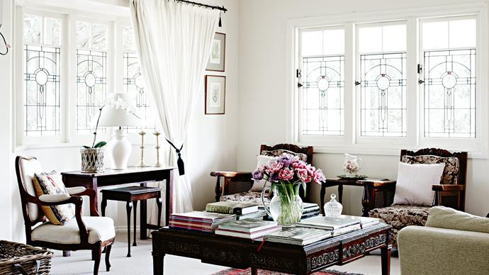 """[Stained-glass windows](https://www.homestolove.com.au/stained-glass-19272 target=""""_blank"""") and antique furniture are a match made in heaven in this country holiday home. *Photo: Mark Roper*"""