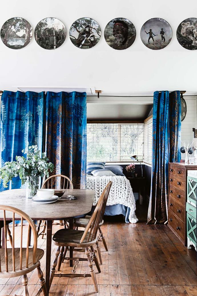 """The antique dining table, above, is a family heirloom, and the plates lining the wall are vintage [Royal Doulton](https://www.royaldoulton.com.au/ target=""""_blank"""" rel=""""nofollow"""")."""