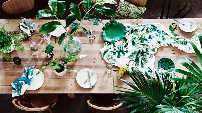 1. Add plants to table settings. Whether you're hosting dinner for a group or just having weeknight pasta, greenery on the table is always a good idea. We love mixing the height and volume of plants— go for low succulents as well as higher, more full bouquets. | Photo: Lisa Cohen
