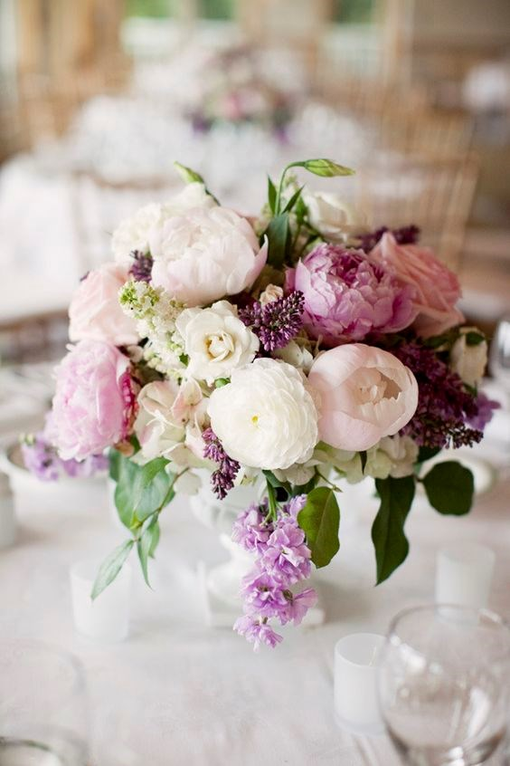 If your budget allows, use peonies to style your venue, as well as in your bouquet.  Image by [Kate Preftakes](http://preftakesphoto.com/)