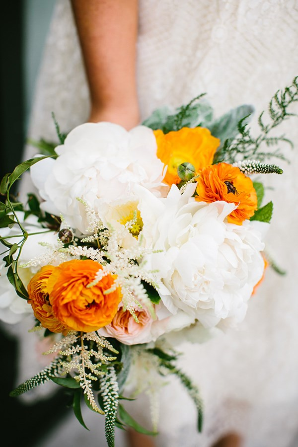 This combination of creamy white and sunny orange peonies is like summer in a bouquet.  Image by [Pen Carlson](http://pencarlson.com/)