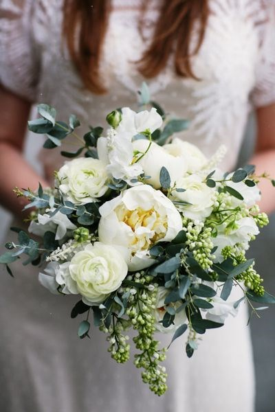 A simple, exquisite bouquet of creamy white peonies with spring green buds looks classic and elegant.  Image by [Tracey Buyce](http://www.traceybuyce.com/)