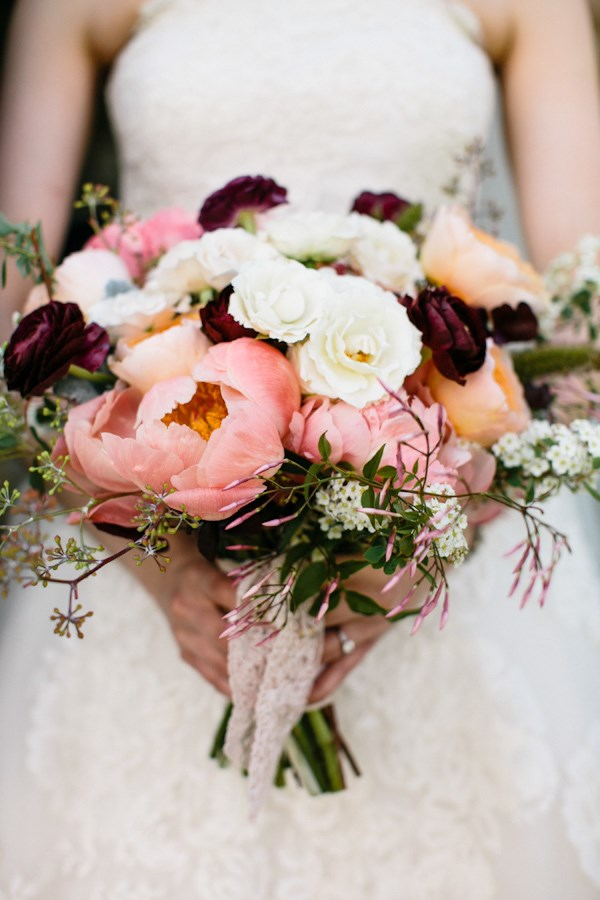 A mix of deep purple, pastel pink and off-white peonies looks fresh and feminine.  Image by [Joyelle West](http://www.jwestwedding.com/)