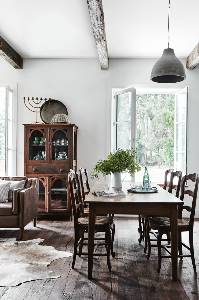 French provincial furniture and rustic exposed ceiling beams give them home an understated elegance.