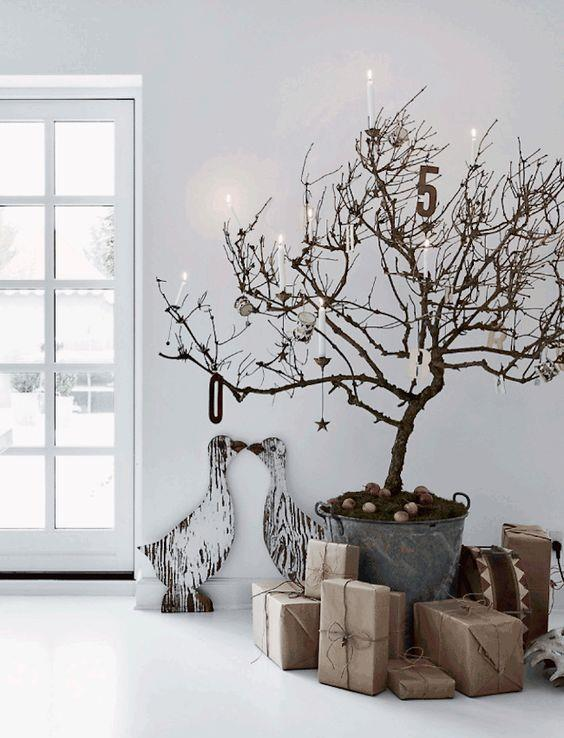 You don't have to go for a traditional fir tree. We love this sparse alternative – all the better for hanging decorations and candles. Via [Dust Jacket Attic](https://www.pinterest.com.au/source/dustjacket-attic.com/)