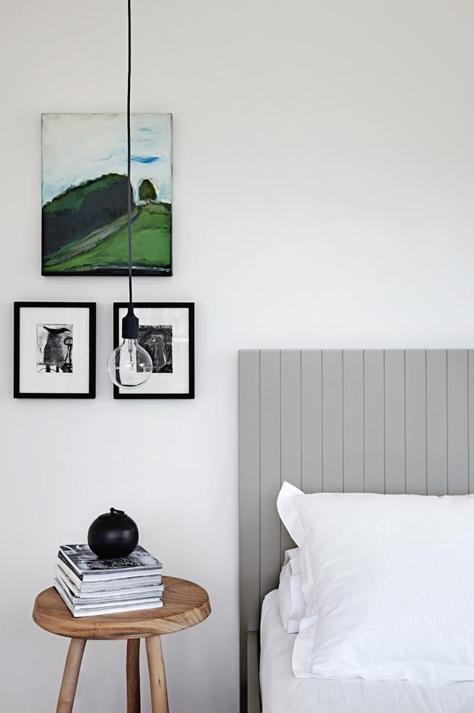 """In the main bedroom, an oil painting and two drawings by Daylesford's [Kim Barter](http://kimbarterart.com/
