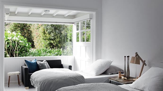 """The bay window (with its original timber panelling now revealed) looks out to the garden. An IKEA sofa bed is handy for young children in the guest bedroom, which is furnished with an antique lifebuoy from Mornington's [Big Chair Living](http://bigchair.com.au/