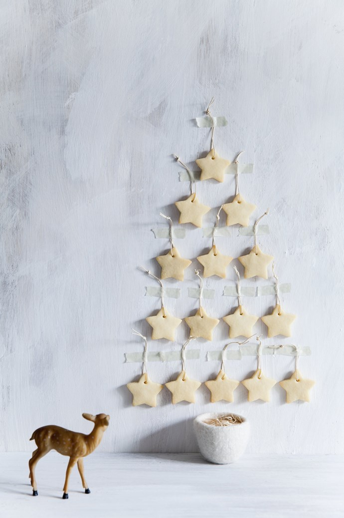 "This Christmas tree tastes as good as it looks. Using a simple [shortbread recipe](https://www.homestolove.com.au/spiced-shortbread-stars-8279|target=""_blank""), cut the biscuit dough into stars and affix to the wall in a tree shape. The best part? You'll actually look forward to cleaning this tree up! 