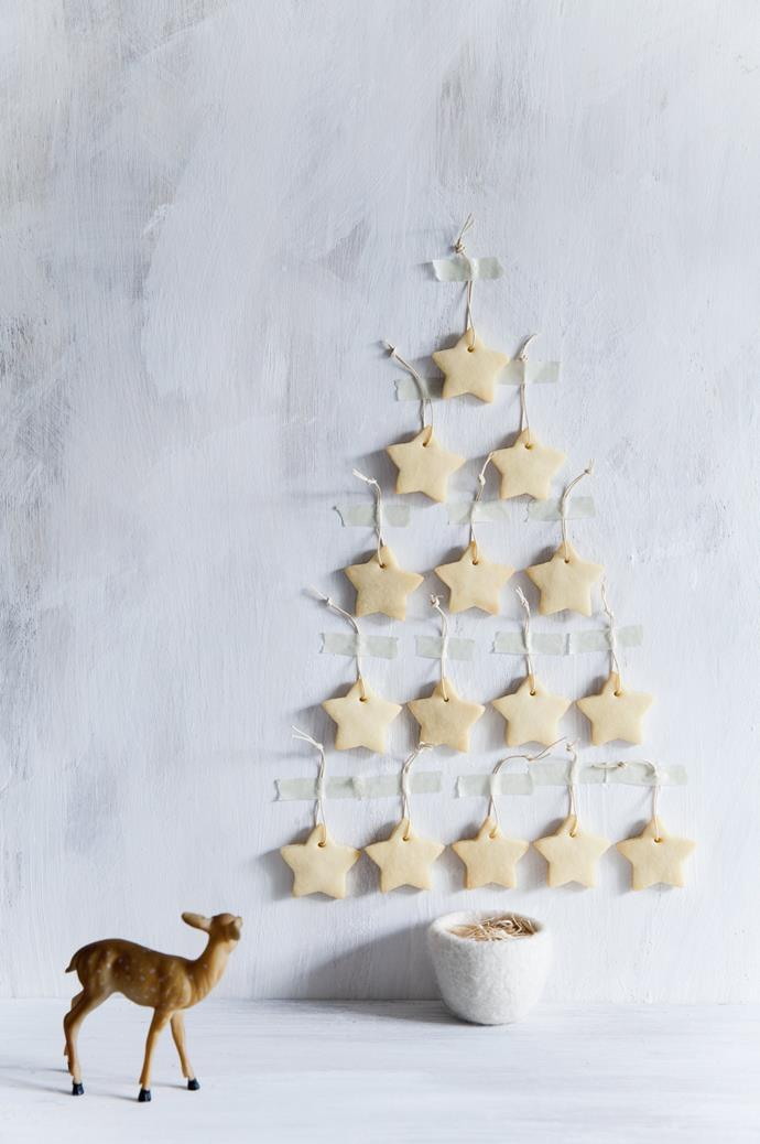 "**Edible Christmas tree:** This Christmas tree tastes as good as it looks. Using a simple [shortbread recipe](https://www.homestolove.com.au/spiced-shortbread-stars-8279|target=""_blank""), cut the biscuit dough into stars and affix to the wall in a tree shape. The best part? You'll actually look forward to cleaning this tree up!"