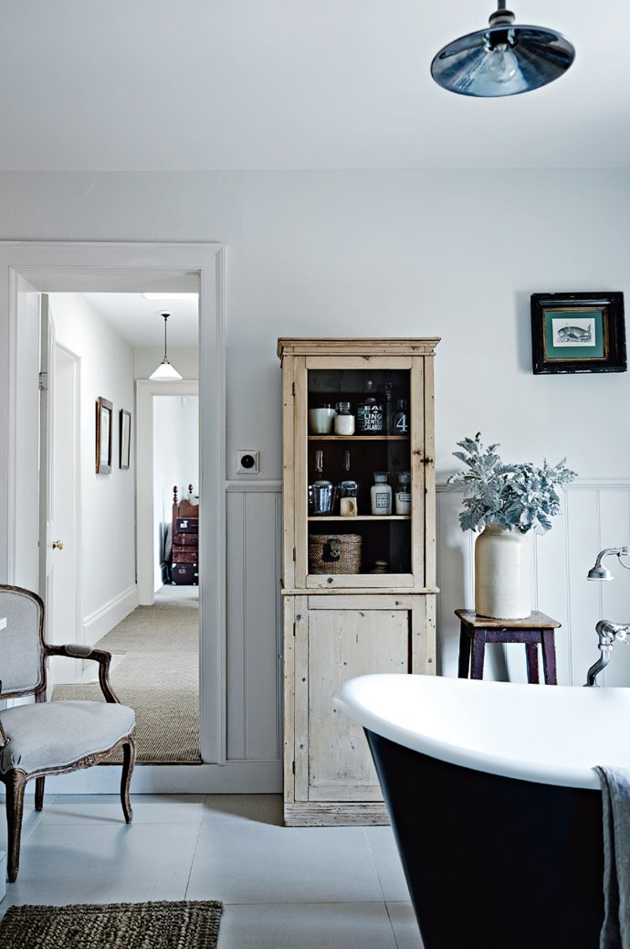 Once the Skippers discovered rotting floorboards and joists in their new house, they dug back the layers and undertook a major restoration that focused on improving warmth and light. The main bathroom includes a [Burmark](http://www.burmark.co.nz/) bath which was imported from New Zealand. The cupboard was bought at a local auction and the light is from [Emac & Lawton](http://www.emac-lawton.com.au/). | Photo: Mark Roper